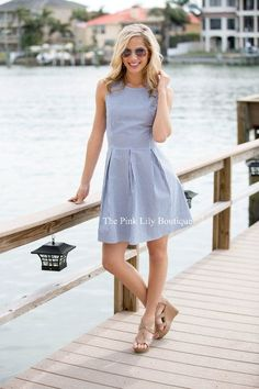 This adorable seersucker dress is simply perfect for a bright spring day or breezy summer afternoon! Featuring a classic navy and white seersucker material, it's so easy to love this lightweight mater
