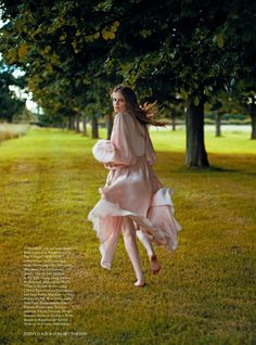 Going barefoot, the model wears a silk and satin dress from Rosamosario