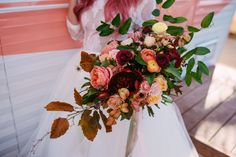 Colorful wedding bouquet, loose leaves, red and pink florals // Nikki Marie Photography