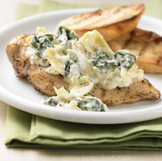 Spinach and Artichoke Topped Chicken… Looking to use your grill more this summer? This recipe is for you! Heart healthy and veggies infused, try this dish and pair it with some grilled potatoes to complete the summertime meal.