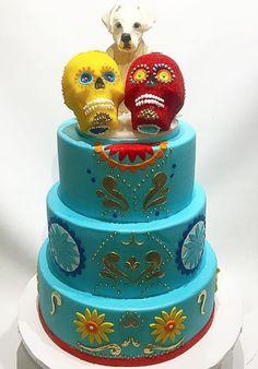 Day of the dead inspired wedding cake !!  Sugar skulls:)