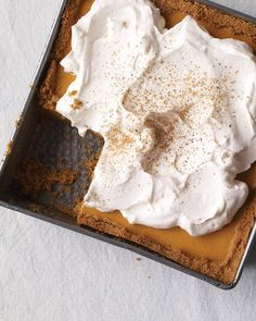Pumpkin Icebox Pie This pumpkin icebox pie is an easy Thanksgiving dessert that everyone will love. The no-bake pumpkin filling gets its silky texture courtesy of cream cheese and gelatin. Get the Pumpkin Icebox Pie Recipe Just Desserts, Delicious Desserts, Dessert Recipes, Yummy Food, Dessert Healthy, Pie Dessert, Pie Recipes, Healthy Recipes, Pumpkin Recipes