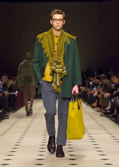 A dark forest green caban in bonded cashmere with Scholar Eyewear and The Burberry Carryall