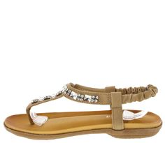 These summer sandals are the perfect sparkling addition to your wardrobe - Features a rhinestone embellished style upper - Slightly wedged heel and scrunch elastic opening for easy wear Man made mater