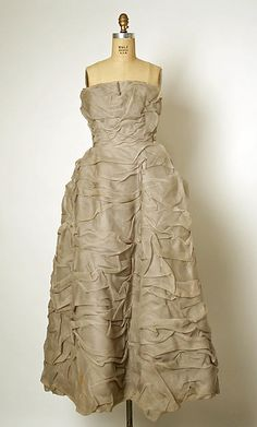 Evening dress Design House: House of Balenciaga (French, founded 1937) Designer: Cristobal Balenciaga (Spanish, Guetaria, San Sebastian 1895–1972 Javea) Date: ca. 1955 Culture: French Medium: silk Dimensions: [no dimensions available] Credit Line: Gift of Mrs. Michael Blankfort, in memory of her mother, Mrs. William Constable Breed, 1976