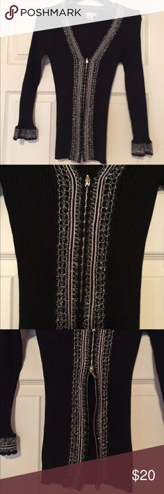 """""""CACHE"""" SILK EMBROIDERED SWEATER! Beautiful black silk sweater by Cache! Fitted with a low V-beck cut. Silver Embroidered accents in the front and on 3/4 length sleeves. Wear it zipped up or give a sexy look and give more room on the hips by opening the double zipper as shown in third picture. Size small fitting a size 2 or 4. No stains or damage. Cache Sweaters V-Necks"""