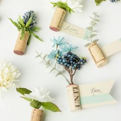 Upcycle wine corks by making them into unique place card holders for weddings…