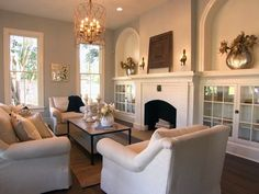 My favorite house/ favorite living room from Fixer Upper!  The fireplace, the built ins, the windows, the styling!
