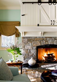 Mantle w/batton board... love the idea to cover the TV sliding doors on track.