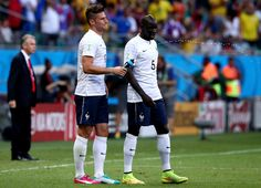 Olivier Giroud Photos Photos - Olivier Giroud of France sprays water as Mamadou Sakho of France looks on during the 2014 FIFA World Cup Brazil Group E match between Switzerland and France at Arena Fonte Nova on June 20, 2014 in Salvador, Brazil. - Switzerland v France: Group E