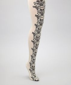 Take a look at this Cream & Black Lotus Tights by Anna Sui on #zulily today!