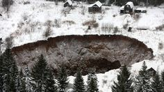 Sinkhole opens up near old mine in Russia's Ural Mountains