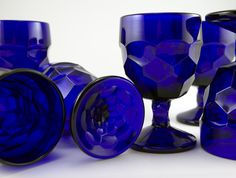 I repined this from http://retroartglass.com/content/00/01/40/15/01/userimages/Vintage%2520cobalt%2520blue%2520glass/Cobalt-blue-glassware-set.jpg3
