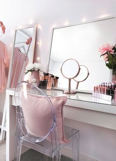 Beauty room, makeup vanity and storage with Ikea Malm dressing table, Ikea mirror and Target chair. Flowers, makeup brushes and lipstick holder. Pretty makeup vanity, storage, organisation goals and inspiration.