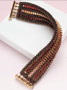 """Symetrie Bracelet,"" by Lisa Kan. Art Deco inspired, symmetrical CRAW with triangle beads worked into the design."
