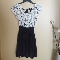 Super cute polka dot dress ❤️ Never worn ✨ super adorable ✨ ties in the back ✨ black & white polka dot dress ✨ perfect for summer ✨ silk material ✨ Dresses Midi