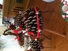 Reindeer craft made from a big pine cone & small pine cone, ribbon & cinnamon stick legs :)