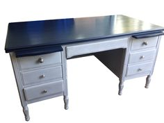 Old executive desk...solid walnut! Used General Finish Coastal Blue on the top and Annie Sloan Paris Grey on the base.