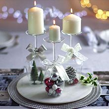 Candles on upside down wine glasses   Christmas table decoration   Tesco Living