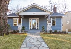 Masters of Flip luxe lodge blue siding exterior and stone path with sod lawn and landscaping Landscape Design Small, Lawn And Landscape, Modern Garden Design, House Landscape, Masters Of Flip, Cottage Lounge, Blue Siding, House Flippers, Backyard