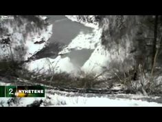 Tow truck and tractor trailer roll over cliff in Northern Norway