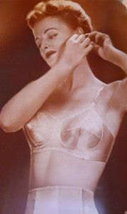 By the 1940s, bras had to be durable for women working long shifts in factories and on the farm [ Land Girls ] and the busty sweater girl look came along via Hollywood starlets like Lauren Bacall and Jane Russell. Military inspired bras were fashionable with torpedo and conical shapes abounding.  http://glamourdaze.com/2013/03/a-brief-history-of-the-bra.html