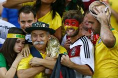 Brazilians are facing the hard choice between supporting their semi-final conquerors, Germany, or their historic rivals, Argentina, in the World Cup final. Brazil Vs Germany, Germany Team, Soccer Fans, Football Fans, World Cup 2014, Fifa World Cup, Football Cheerleaders, Cheerleading, Tottenham Hotspur