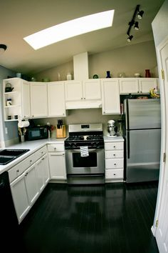 Split level kitchen, paint cabinets white, add pantry