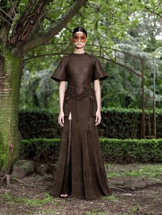 Not really sure why, but I like this, earth warrior chic or something.  [Givenchy Fall 2012 Couture - Vogue]