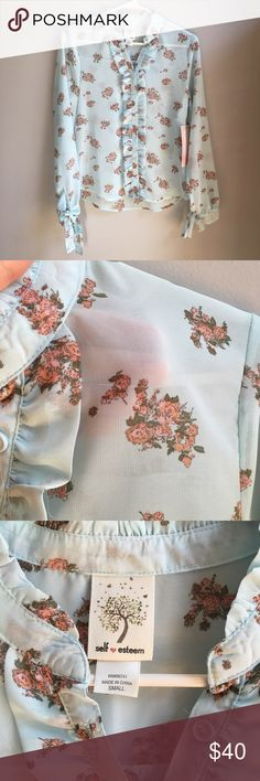 Just In! New Sheer Peasant Blouse Brand: Self Esteem  Condition: BRAND NEW with attached tags  Size: Junior's sizing, in sizes shown.  Material: 100% polyster  Super pretty sheer pale blue top with a floral print. Ruffles down front button line and ties at wrists. Full-length sleeves. Self Esteem Tops Blouses