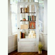 20 Simple and Creative Ideas Of How To Reuse Old Doors - Door bookshelf