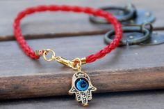Red string vegan leather kabbalah bracelet evil eye, Kabbalah Madonna hamsa by baraki on Etsy https://www.etsy.com/listing/175392382/red-string-vegan-leather-kabbalah