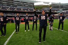 Patrick Kane hoists the Cup for the fans attending Sunday's Bears game. #Blackhawks