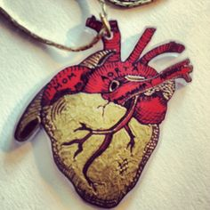 Heart of Gold Hand Painted Shrink Art Necklace. $12.00, via Etsy.