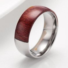 Are you looking for a unique men's wedding band? Look no further than this beautifully HAND-CRAFTED , LIMITED EDITION titanium wedding band with mahogany wood