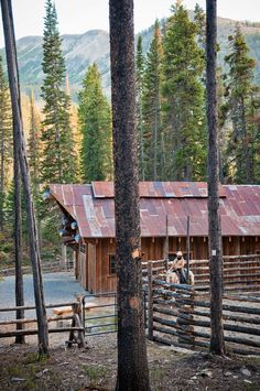 Fence for riding arena by barn, neat barn roof, too Equestrian Stables, Yellowstone Club, Jackson Hole Wyoming, Dream Barn, Western Homes, Mountain Homes, Red Barns, Horse Farms, Big Sky