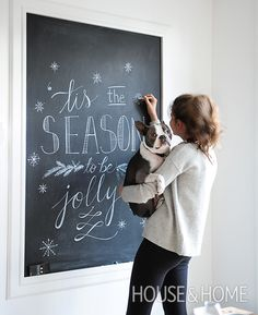 A framed chalkboard in this kitchen is used for hand-drawn holiday menus and messages.   Photographer: Tracey Ayton   Designer: Corinne Isherwood