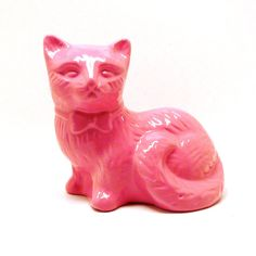 pink cat figurine  //  mod, upcycled ceramics, kitsch cats, funky home decor, bubblegum pink accents, home accessories. $20.00, via Etsy.
