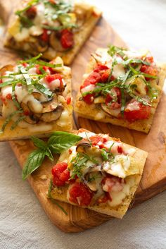 Tomato-Mushroom Focaccia Bites: These tasty little flatbreads topped with tomatoes, mushrooms and mozzarella cheese are the perfect starter for your summer parties.