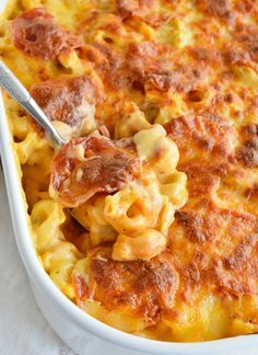 If you love macaroni & cheese and pepperoni pizza you will flip for this Cheese Tortellini Pepperoni Pizza Casserole Recipe! This tortellini mac & cheese is combined with the flavors of pepperoni pizza then baked to bubbly, cheesy perfection!!