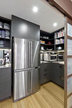 Hidden pantry behind sliding doors. Head is spinning.