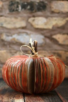 This easy book pumpkin project turns out AMAZING and is an easy way to upcycle a book into a frugal fall craft.