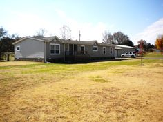 Still smells like NEW!!!Beautiful 4 bedroom, 2 bath 2012 Grandview presidential series double-wide mobile home sitting on approx. 1 acre of land in Big Sandy TN