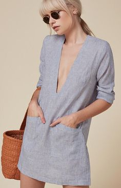 Reformation blue and white striped deep plunge long sleeved linen mini dress