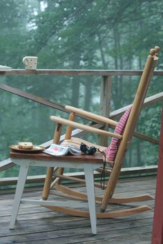 perfect...a DECK over looking the TREES, a ROCKING CHAIR, a cup of Tea or COFFEE, and a BOOK. Yep, PERFECT!