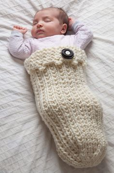 Free Knitting Pattern for Easy 2 Row Repeat Swaddle Your Baby Cozy - Baby cocoon sleep slack is knit with a 2-row repeat Broken Rib stitch. Quick knit in super bulky yarn. Rated easy by the designer Designed by Lorna Miser