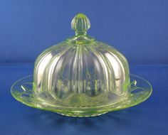 Depression Glass Price Guide: Colonial, Hocking Glass Company, 1934-1936. Butter Dish - Green. Value: $35