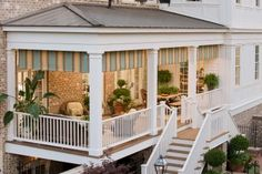 Traditional White Porch With Outdoor Furniture