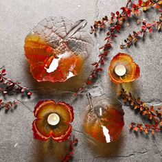 Crystal Bowls and votives in shape of leafs handmade at Målerås Glassworks. Design Mats Jonasson