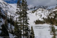 Frozen over and snow covered Crater Lakes